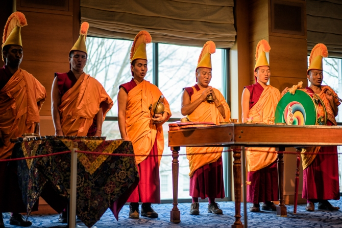 The monks open the ceremony and bless the site of the mandala through their chanting.