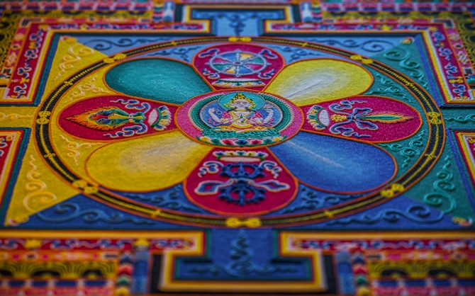 The inner sanctum of the Sand Mandala. The Buddha of Compassion is at the center of the structure. Representations of other deities surround the center, places on eight petals of the lotus flower.