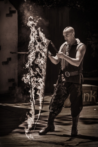Prayers to the fiery serpents. Aaron Bonk with his flaming whips before the Birds of Prey show.
