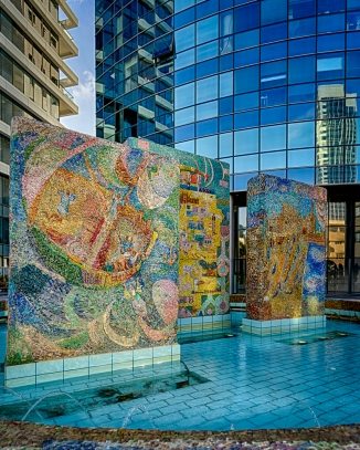 Our walking tour of Tel Aviv on Saturday brought us to this monument. The three mosaics in front of the modern building depict three biblical stories concerning Tel Aviv. The from mosaic tells the story of Jonah that is set in nearby Jaffa (Joppa in English Bible Translations). The center mosaic tells the story of building the temple, and the furthest mosaic depicts the transportation of cedars to Jerusalem. Around the fountain, there are more mosaics depicting the history of Tel Aviv throughout the ages into modern times.